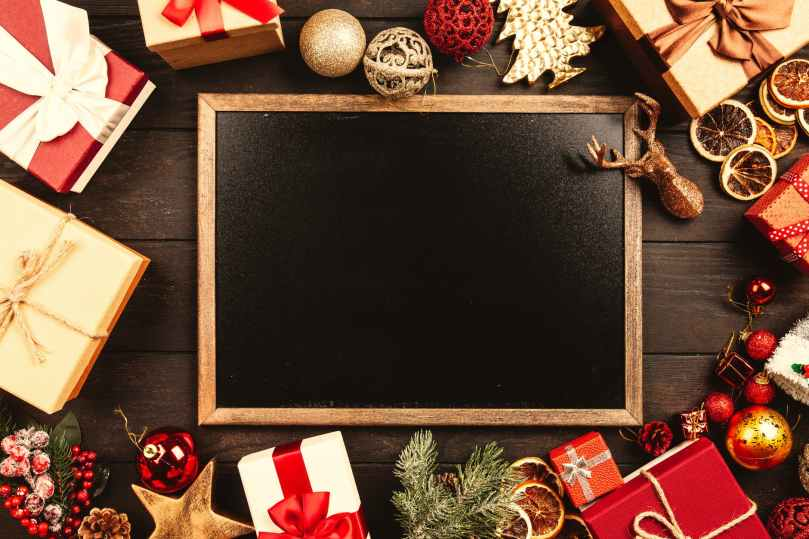 chalkboard surrounded by christmas gifts